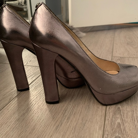 MK all leather silver high heel pumps $65, 6.5 US
